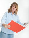 Panicked woman reading examining a book Royalty Free Stock Photography