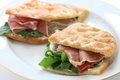 Panini italian sandwich focaccia on white dish Stock Photography