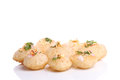 Panipuri stuffed with tasty masala number of are and placed near to each other and isolated against white background Stock Photo