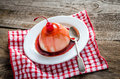 Panna cotta with berry sauce and maraschino cherry Stock Images