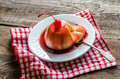 Panna cotta with berry sauce and maraschino cherry Royalty Free Stock Photos
