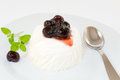 Panna cotta with black cherry syrup Stock Photo