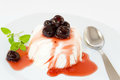 Panna cotta with black cherry syrup Royalty Free Stock Images
