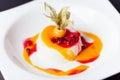 Panna cotta coconut with mango sauce and lingonberry jam Stock Photos