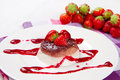 Panna cotta dessert with strawberry sirup and fresh strawberry Stock Images