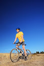 Panning shot of a bicycle rider riding a bike outdoors Stock Photo