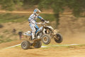 Panning shot of quad rider in jump. Royalty Free Stock Photos