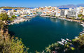 Panorama of Agios Nikolaos or Ayios, Aghios town in Crete, Greece. Showing famous places: Lake, Marina, Bay, Old town. Royalty Free Stock Photo