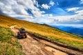 Panorama ATV Quad Bike riders on beautiful mountain landscape Royalty Free Stock Photo