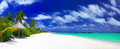 Panorama of beautiful beach on maldives perfect with white sand turquoise water green coconut palms and blue sky with white clouds Royalty Free Stock Photos