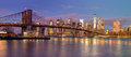 Panorama of Brooklyn Bridge and Manhattan skyscrapers at sunrise Royalty Free Stock Photo