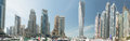 Panorama of dubai marina uae skyscrapers in united arab emirates great view small port with luxury boat decked and in the middle Royalty Free Stock Photo