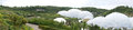 Panorama of eden project biomes in cornwall the the garden old abandond clay mine st austell Royalty Free Stock Photos
