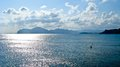 Panorama of the evening sea with dense clouds and mountains Stock Photography