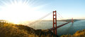 Panorama of golden gate bridge san francisco at dawn the in with the sun rising on the left Royalty Free Stock Images