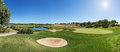 Panorama of a golf course sand trap and collar on sunny day Royalty Free Stock Photography