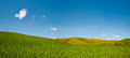 Panorama green sloping meadows tuscany Stock Photo