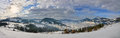 Panorama haystack on the top of snow mountain and cloudy blue s mountains sky Stock Photos