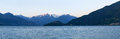 Panorama of the lake of como from the beach at evening sunlight pianello del lario italy Royalty Free Stock Photos