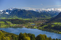 Panorama landscape in bavaria of rural with alps mountains and lake alpsee Royalty Free Stock Images
