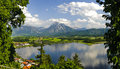 Panorama landscape in bavaria of rural with alps mountains and lake hopfensee Stock Photography