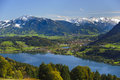 Panorama landscape in bavaria rural with lake alpsee and alps mountains germany nearby city immenstadt Stock Images