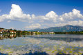 Panorama landscape in bavaria view over rural with alps mountains and lake hopfensee Stock Photography