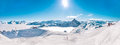 Panorama of mountain range winter landscape in french alps with blue sky and skiing slopes at meribel skiing resort Royalty Free Stock Photography
