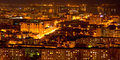 Panorama of nightlife russia the evening city of saratov with volga river Stock Image