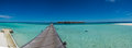 Panorama of the ocean at the tropical beach at the island Maldives Royalty Free Stock Photo