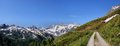 Panorama of the oetztal alps snow capped mountains in south tyrol italy hiking path and cloudless blue sky Stock Images