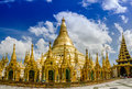 Panorama of pagodas encircle the gilded stupa of shwedagon pagoda base yangon myanmar some prayers and tourists resting under Royalty Free Stock Photography