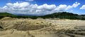 Panorama picture of muddy vulcanos a vulcano similar to selenar landscape in buzau county paclele mari romania Royalty Free Stock Image
