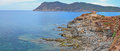 Panorama of porto ferro tower sardinia italy eroded cliffs and medieval watchtower in bay near alghero in island Royalty Free Stock Photos