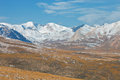 Panorama of ridges and valleys in the fall in the tien shan issyk kul region kyrgyzstan slopes steppe snow sky rocks Royalty Free Stock Image