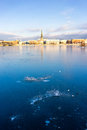 Panorama of Riga with reflection in a frozen river Daugava Royalty Free Stock Photo