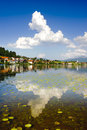 Panorama rural landscape in bavaria with lake hopfensee nearby alps mountains Royalty Free Stock Images