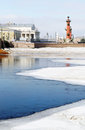 Panorama of saint petersburg in winter snow covers the neva river partly melting blue water rostral column reflected in the water Royalty Free Stock Photography