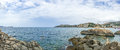 Panorama scene of rocky ocean shoreline Royalty Free Stock Photo