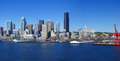 Panorama seattle waterfront skyline with ferry and dockyard cranes puget sound pacific northwest Stock Photo