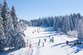 Panorama of ski resort Kopaonik, Serbia, people skiing, houses covered with snow Royalty Free Stock Photo