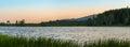 Panorama of a small lake at dusk Royalty Free Stock Photo