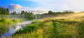 Panorama of a summer landscape with sunrise, fog and the river Royalty Free Stock Photo