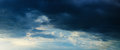 Panorama - sunbeams in stormy dark cloudy sky Royalty Free Stock Photography