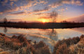 Panorama of sunrise on the river in spring Stock Photo