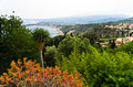 Panorama of Taromina bay from botanical garden, mount Etna in background, Sicily Royalty Free Stock Photo