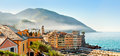 Panorama of town camogli in fog in the morning panoramic view on top Stock Images