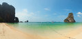 Panorama of tropical beach with rocks thailand krabi railay sand and azure water Stock Photos