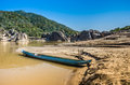 Panorama view pf mekong river with a light blue longtail boat ready to leave Stock Photos