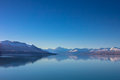Panorama view of snow, mountain layer, ice and lake with reflect Royalty Free Stock Photo